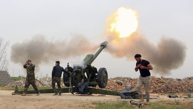 Iraqi security forces fire at Islamic State militants positions from villages south of the Islamic State group-held city of Mosul, Iraq, Saturday, March 26, 2016. The Iraqi military backed by U.S.-led coalition aircraft on Thursday launched a long-awaited operation to recapture the northern city of Mosul from Islamic State militants, a military spokesman said.