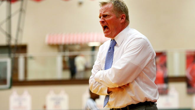 Carmel head girls basketball coach Tod Windlan gets after his team during the Larence North game on Dec. 1, 2015.