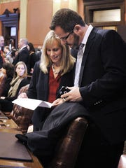 Rep. Cindy Gamrat, R-Plainwell, talks with Rep Todd