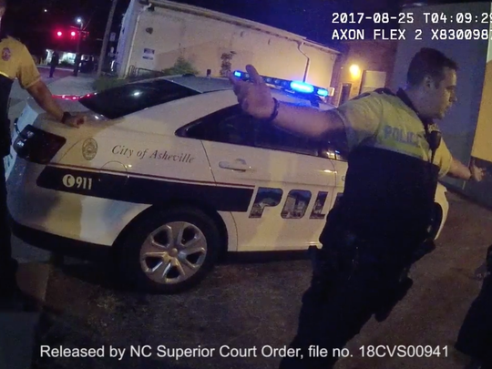 A screengrab from the recording of the body-worn camera of Senior Police Officer Shawn Parker on August 25, 2017, at 12:07 a.m. SPO Parker arrived to the scene as Mr. Rush is being walked across the street to Hickman's patrol vehicle.