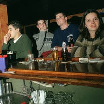 A small group of customers enjoy the Celtic atmosphere at Mulligan's Irish House on New Hackensack Rd. in the Town of Poughkeepsie on Tuesday night, October 23rd., 2002.