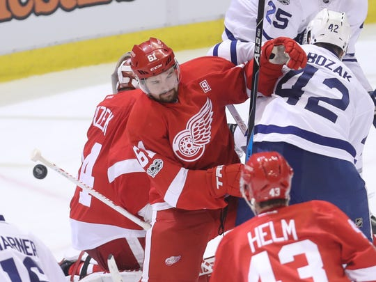 Detroit Red Wings defenseman Xavier Oullet defends against Toronto Maple Leafs center Tyler Bozak during the second period Wednesday, Jan. 25, 2017 at Joe Louis Arena.