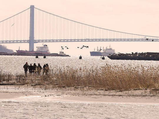 A protest and nature walk March 3, 2018, aims to prevent a plan for a golf course to expand to Caven Point in New Jersey's Liberty State Park.