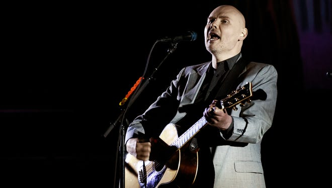 FILE - In this Saturday, March 26, 2017 file photo, Billy Corgan of the Smashing Pumpkins performs at The Theatre at Ace Hotel in Los Angeles. Billy Corgan is more than just another celebrity immersed in wrestling as some sort of quirky promotional stunt. The Smashing Pumpkins lead singer has been involved in wrestling for more than a decade. But his next step is his biggest gamble yet. Corgan now owns the NWA - the old 1970s and 80s home of Ric Flair and Harley Race, among other greats, and hopes to return the forgotten promotion to relevance, Saturday, Nov. 11, 2017. (Photo by Chris Pizzello/Invision/AP, File)