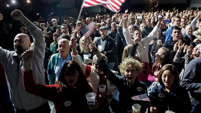 Supporters cheer as they watch election results on TV during Wisconsin Republican Gov. Scott Walker's campaign party Tuesday, Nov. 4, 2014, in West Allis, Wis. (AP Photo/Morry Gash)