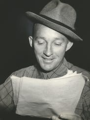 Bing Crosby reads a radio script in this 1956 photo.