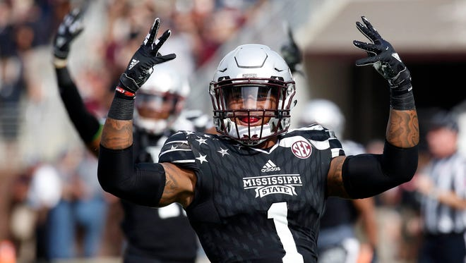 Mississippi State defensive back Brandon Bryant (1) and his teammates signal the beginning of the fourth quarter against Texas A&M during their NCAA college football game in Starkville, Miss., Saturday, Nov. 5, 2016. Mississippi State won 35-28. (AP Photo/Rogelio V. Solis)