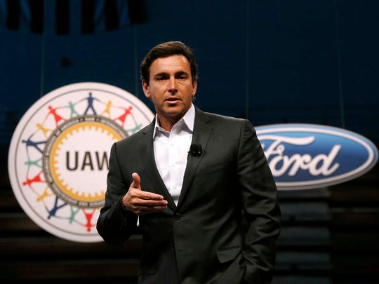 On July 23, 2015, Ford Motor Company President and CEO Mark Fields speaks during a ceremony to mark the opening of contract negotiations with the United Auto Workers in Detroit. Fields said Tuesday, Aug. 16, 2016, that Ford Motor Co. will have a fully autonomous vehicle ready to provide ride-hailing or ride-sharing services by 2021.