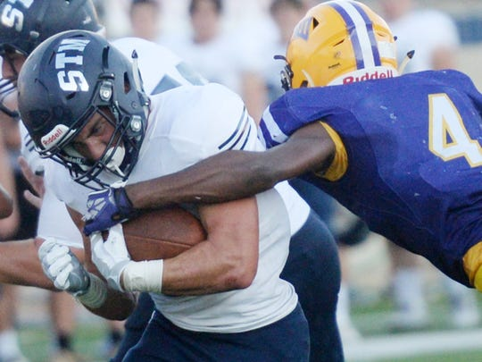 St. Thomas More's Beau Moncla tried to get past Byrd's Chondrick Lofton in the Battle on the Border Thursday evening at Independence Stadium.
