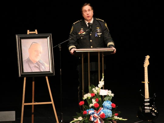 Oakland County Sheriff Michael Bouchard speaks at the funeral service for Oakland County Sheriff's Deputy Eric Overall, who was killed on Thanksgiving morning while pursuing a suspect.