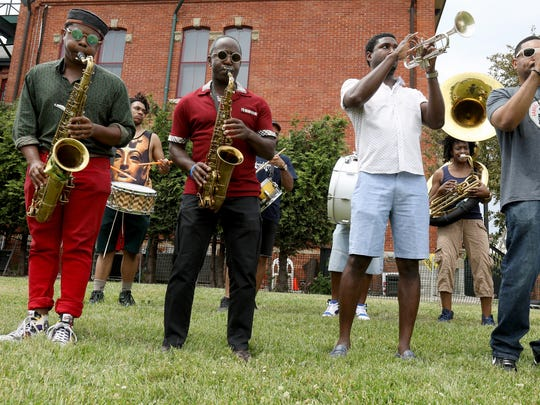 Members of the Gabriel Brass Band, from left, Xavier Bonner, Wayne Henry, Zack Orton and Dameon Gabriel, all of Detroit, play during the Juneteenth festival in the Brush Park neighborhood in Detroit on Saturday, June 16, 2018. The festival celebrates the end of slavery in 1865.