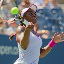 Aug 27, 2014; New York, NY, USA; Sloane Stephens (USA) in action during her match against Johanna Larsson (SWE) on day three of the 2014 U.S. Open tennis tournament at USTA Billie Jean King National Tennis Center. Mandatory Credit: Susan Mullane-USA TODAY Sports