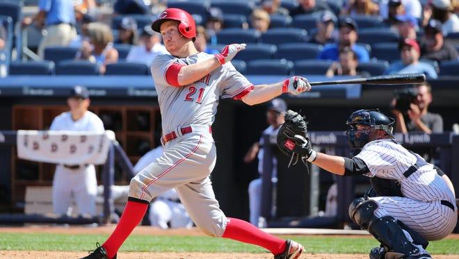 Cincinnati Reds third baseman Todd Frazier (21) hits a home run to left during the eighth inning against the New York Yankees at Yankee Stadium. New York Yankees won 3-2.