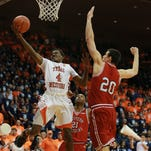 UTEP's Lee Moore scores against Western Kentucky's Aleksej Rostov during the second half Saturday. The Miners travel to Florida on Thursday.