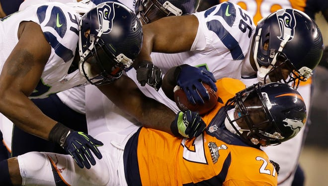 DE Cliff Avril (56) and the Seahawks D put Knowshon Moreno and the Broncos offense on ice all night.