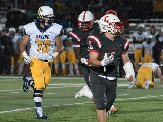 Lou Baechler (1) makes a run for the end zone after