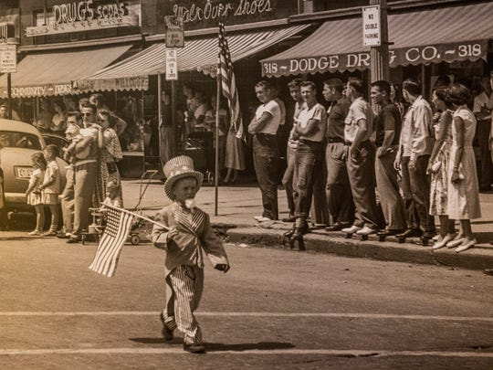 A mural photograph on the wall of the restaurant is from the Fourth of July parade in downtown Plymouth in 1950.