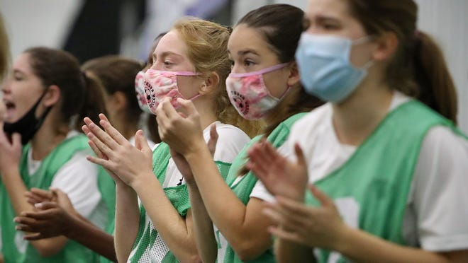 Park Tudor Panthers wear masks while watching from the sidelines during the overtime period of IHSAA Class A finals at Grand Park in Westfield, Ind., on Oct. 30, 2020. Lafayette Central Catholic won in penalty kicks, 9-8. The soccer game was held with precautions due to the coronavirus pandemic.