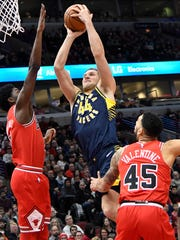 Dec 29, 2017; Chicago, IL, USA; Indiana Pacers forward Bojan Bogdanovic (44) goes to the basket as Chicago Bulls guard Justin Holiday (7) defends him during the first half at United Center. Mandatory Credit: David Banks-USA TODAY Sports