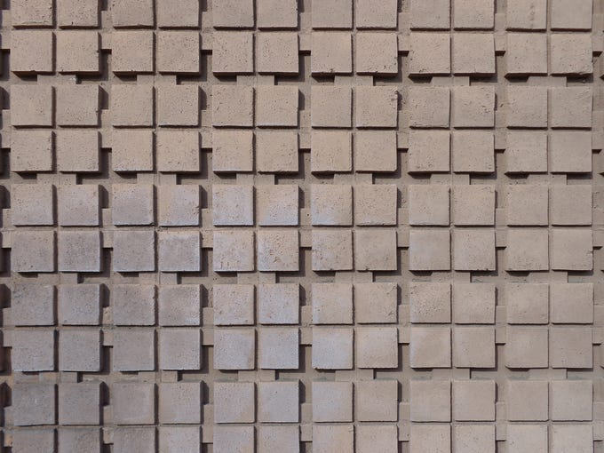 Patterned concrete wall.