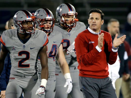 FILE - In this Nov. 4, 2016, file photo, Connecticut coach Bob Diaco watches his players warm up for an NCAA college football game against Temple in East Hartford, Conn.  UConn athletic director David Benedict announced Monday, Dec. 26, 2016, that head football coach Bob Diaco has been relieved of his coaching duties, effective Jan. 2.  (AP Photo/Elise Amendola, File)