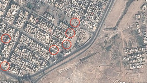 This satellite image taken Oct. 31, 2016, show that the Islamic State has cleared a wide swath of terrain to the north of Mosul airport, along the western bank of the Tigris River. New satellite images show that Islamic State militants in Mosul have set up daunting defenses designed to bog down advancing forces. The images taken Monday and made public by Saturday by Texas-based private intelligence firm Stratfor, show rows of concrete barricades, earthen berms and rubble blocking key routes leading to the core of the city.