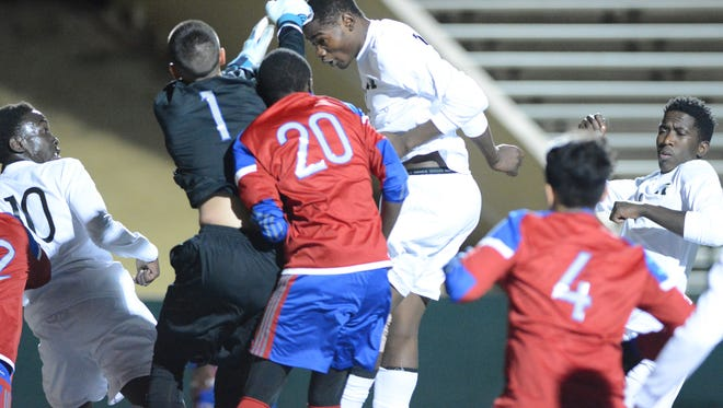 Cooper goalkeeper Nick Silva (1) challenges Blaise Kapinga's header on a corner kick, but the ball is already past him for the only goal in a 1-0 Eagles victory Friday at Shotwell Stadium.