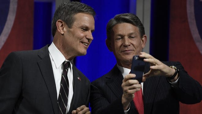 Republicans Bill Lee and Randy Boyd snap a selfie of themselves before the start of the gubernatorial forum on education at Belmont University in Nashville on Jan. 23, 2018.
