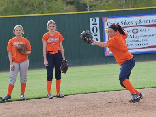 Louisiana College sophomore Heather Scully (far right) runs through drills at practice Thursday. The Lady Wildcats will go to Sulphur to play in the McNeese State University Cowgirl Fall Classic this weekend.