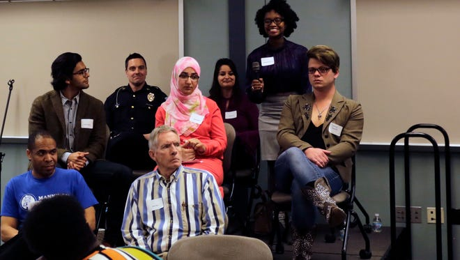 Bethany Gowan stands while speaking as part of panel at Diversity Summit 2017 on April 13, 2017, in Lafayette. From back left to front right, Scott Galloway, Nohemi Lugo, Bethany Gowan, Gautum Bhayani, Lama Abdallah, Jesse Knoth, Dennis Manning and Art Burk all sat on the panel.