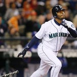 In this 2009 file photo, Seattle Mariners' Ken Griffey Jr. hits a solo home run on a pitch from Texas Rangers' Tommy Hunter during the fourth inning of a baseball game in Seattle.