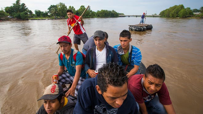 Migrants from Central America illegally cross into Mexico from Guatemala using a raft on the Suchiate River June 22, 2014. They were all headed for the U.S. but weren't sure on the route they were going to take through Mexico.