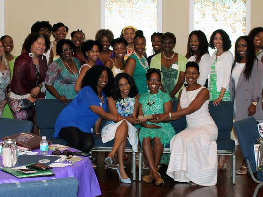 Women come together at the SHE Tea in 2017.