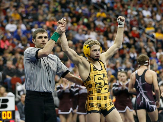 Southeast Polk's Nolan Hellickson wins a Class 3A final at 126 pounds at the 2015 Iowa state wrestling tournament at Wells Fargo Arena. Hellickson, now a wrestler at Harvard, went 3-3 at the Midlands this weekend.