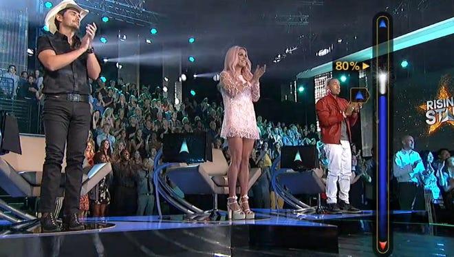 """(L-R) Brad Paisley, Kesha and Ludacris on ABC's """"Rising Star."""""""