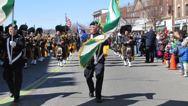 Members of the NYPD Emerald Society Pipes & Drums march in the Sound Shore St. Patrick's Day Parade along Mamaroneck Avenue in Mamaroneck, March 22, 2015.