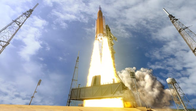 An artist's depiction shows NASA's Space Launch System, the world's most powerful rocket and the only rocket designed to meet the challenges of the journey to Mars.