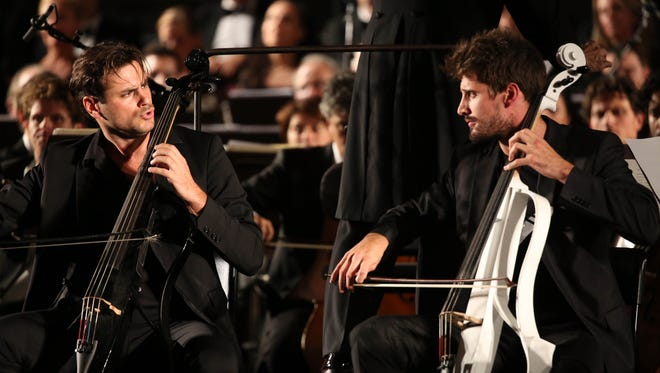 2Cellos performs at the Celebrity Fight Night gala in Florence, Italy, on Sept. 13, 2015.