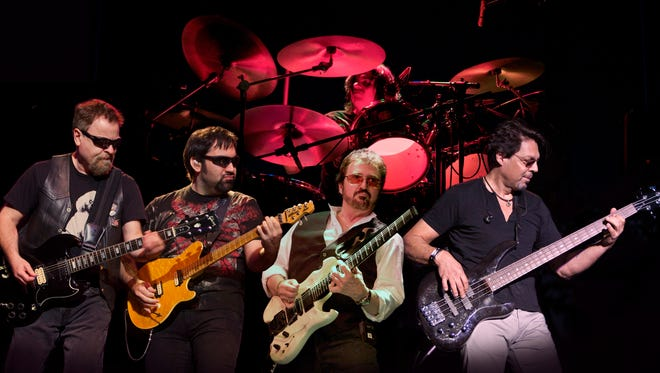 "Blue Öyster Cult, from left: Richie Castellano, Donald ""Buck Dharma"" Roeser, Eric Bloom and former bassist Kasim Sulton. Behind them is Jules Radino on drums. The veteran rock group performs in Englewood on Wednesday."