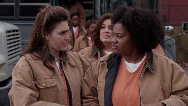 Gretchen (Lauren Adams, left) meets 'Orange Is the New Black' inmate Black Cindy (Adrienne C. Moore) in a crossover episode of Netflix's 'Unbreakable Kimmy Schmidt.'