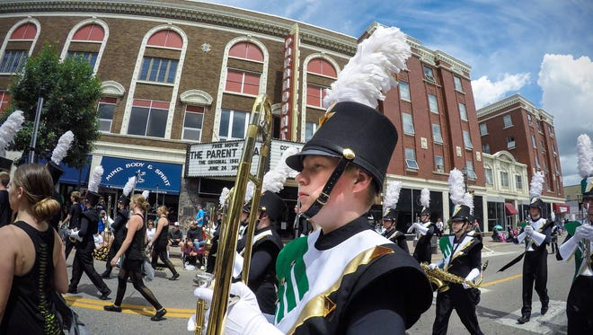 Sauk Rapids-Rice High School Marching Storms band members make their way down St. Germain Street during the Granite City Days Parade Saturday, June 24, 2017 in St. Cloud.