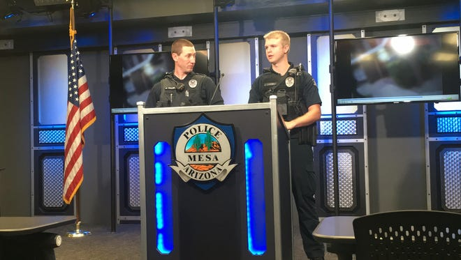 Mesa Police Officers Mike Mullen (left) and Jake Campbell talk about saving an arson suspect from an apartment fire.