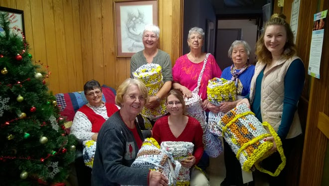 Members of the First Presbyterian Church are shown presenting homeless sleeping mats to Nicole Johnson, executive director of the Solution Center in Fond du Lac,.The Solution Center works with victims of domestic violence, homelessness and other needs. Pictured are, front row from left: Nancy Hilbert, Kristina Arellano and Nicole Johnson; back row: Joyce Mosby, Sandy Vahlsing, Elsie Dahl and Jean Morgan.