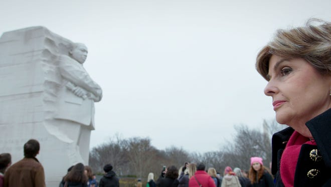 Gloria Allred marches past the Martin Luther King Jr. Memorial in Washington during last year's Women's March, in a scene from Netflix documentary 'Seeing Allred.'