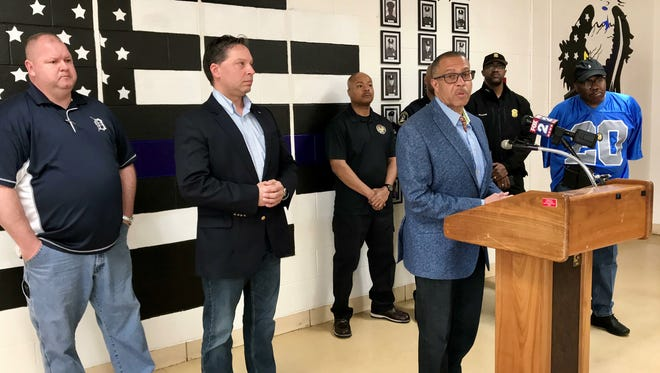 Detroit Police Chief James Craig stands with union representatives during a press conference at the 7th precinct Saturday.