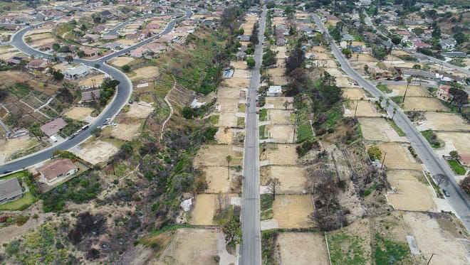 Empty lots where the fire Thomas Fire destroyed homes along Colina Vista in Ventura are shown in this May 23 photo.