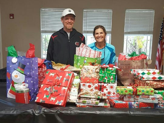 Indian River Tennis Club donated gifts for the youth at the Hibiscus Village.