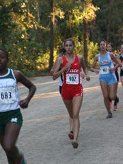Pace High senior Haley Kling approaches the first mile marker in Saturday's Class 3A girls state cross country championships in Tallahassee.