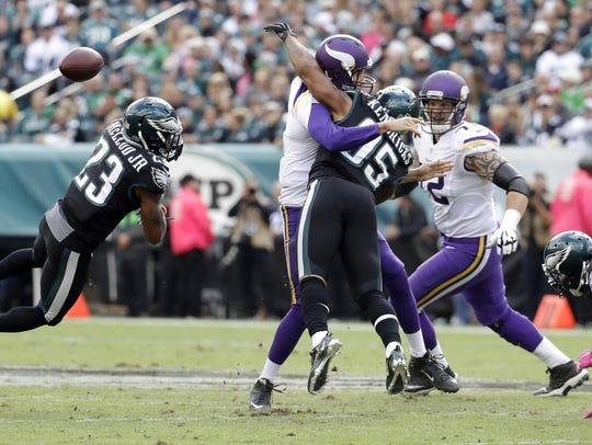 The Minnesota Vikings' Sam Bradford, center, fumbles
