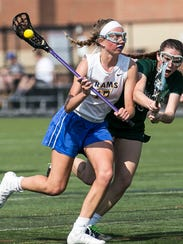 Kennard Dale's Gillian Zimmerman cradles the ball against